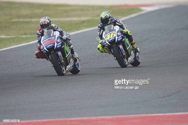 Jorge Lorenzo of Spain and Movistar Yamaha MotoGP leads Valentino Rossi of Italy and Movistar Yamaha MotoGP in the MotoGP World Championship race...