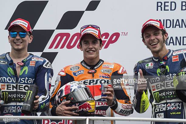 Jorge Lorenzo of Spain and Movistar Yamaha MotoGP Marc Marquez of Spain and Repsol Honda Team and Valentino Rossi of Italy and Movistar Yamaha MotoGP...