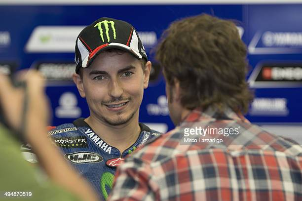 Jorge Lorenzo of Spain and Movistar Yamaha MotoGP speaks in box with Fernando Alonso of Spain in MotoGP during the MotoGp of Italy Qualifying at...
