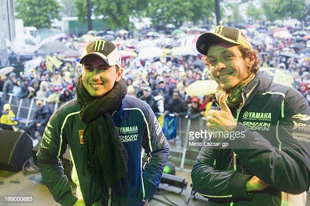 Jorge Lorenzo of Spain and Yamaha Factory Racing and Valentino Rossi of Italy and Yamaha Factory Racing pose for fans during the event Riders and...