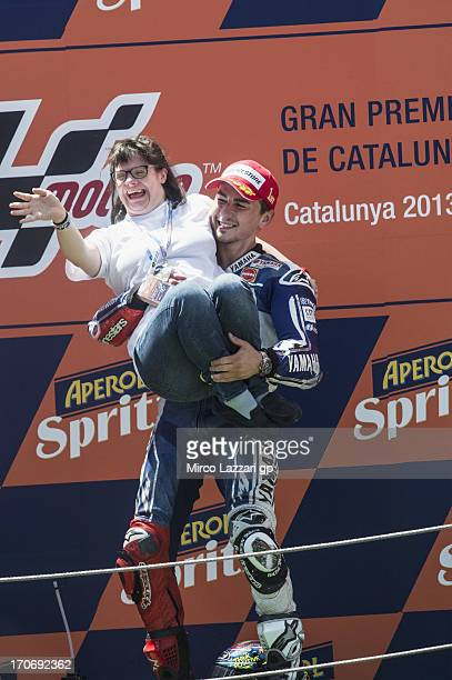 Jorge Lorenzo of Spain and Yamaha Factory Racing celebrates on the podium with Anna Vives the victory at the end of the MotoGP race during the MotoGp...