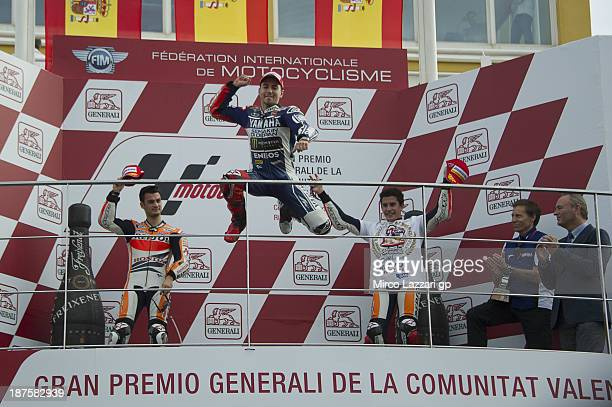 Jorge Lorenzo of Spain and Yamaha Factory Racing celebrates the MotoGP victory on the podium after the MotoGP race during the MotoGP of Valencia Race...