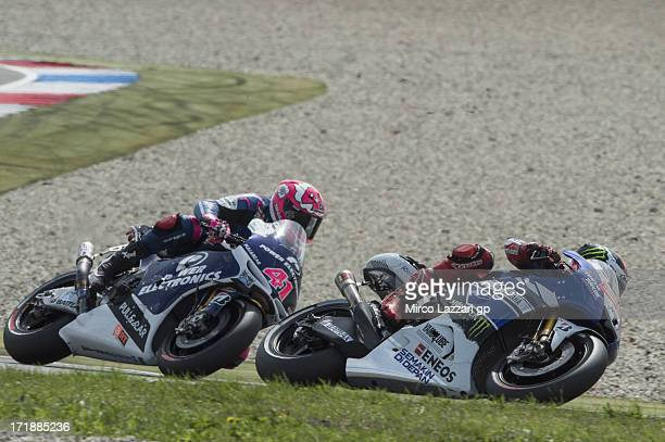 Jorge Lorenzo of Spain and Yamaha Factory Racing leads Aleix Espargaro of Spain and Power Electronics Aspar during the MotoGP race during the MotoGp...