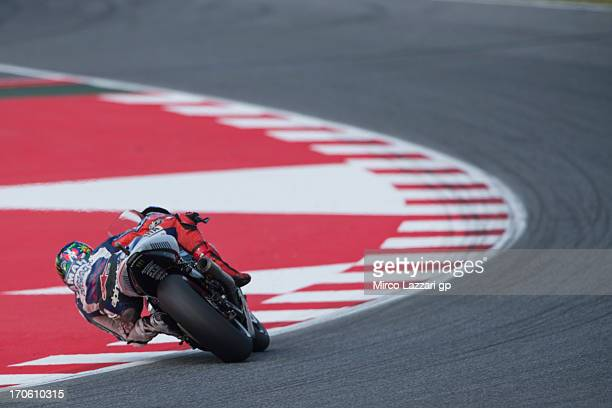 Jorge Lorenzo of Spain and Yamaha Factory Racing rounds the bend during the MotoGp Of Catalunya Qualifying at Circuit de Catalunya on June 15 2013 in...