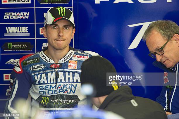 Jorge Lorenzo of Spain and Yamaha Factory Racing speaks with mechanic in box during the qualifying practice of the MotoGp Of France Qualifying on May...