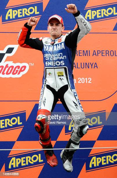 Jorge Lorenzo of Spain and Yamaha Factory Racing Team celebrates on the podium after winning the MotoGP race at Circuit de Catalunya on June 3 2012...