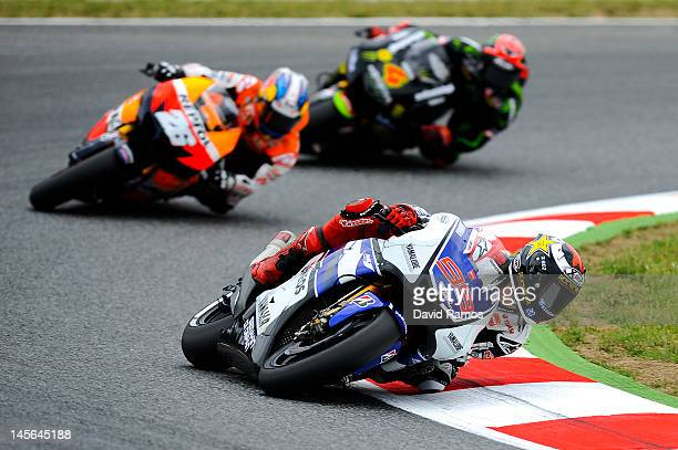Jorge Lorenzo of Spain and Yamaha Factory Racing Team leads Dani Pedrosa of Spain and Repsol Honda Team and Andrea Dovizioso of Italy and Monster...