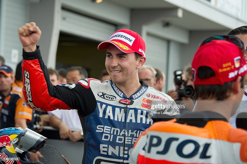 Jorge Lorenzo of Spain and Yamaha Factory Team celebrates coming second under the podium at the end of the MotoGP race of the MotoGp of Germany at Sachsenring Circuit on July 8, 2012 in Hohenstein-Ernstthal, Germany.