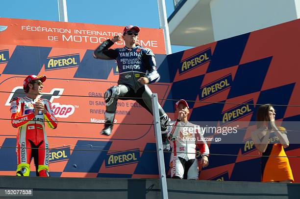 Jorge Lorenzo of Spain and Yamaha Factory Team celebrates the victory on the podium at the end of the MotoGP race of the MotoGP of San Marino at...
