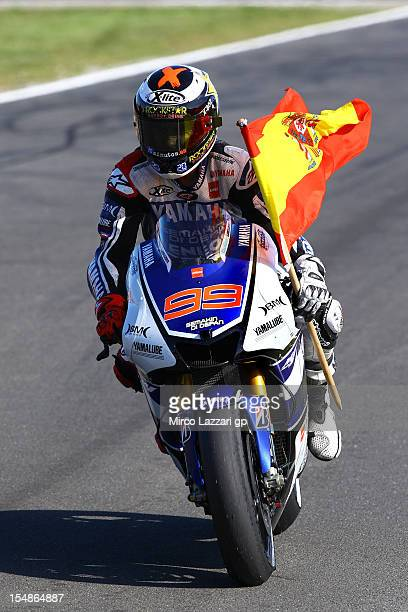 Jorge Lorenzo of Spain and Yamaha Factory Team celebrates with the Spanish flag after achieving second place and overall victory in the MotoGp...