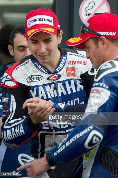 Jorge Lorenzo of Spain and Yamaha Factory Team congratulates with Randy De Puniet of France and Power Electronics Aspar at the end of the qualifying...