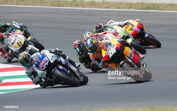 Jorge Lorenzo of Spain and Yamaha Factory team leads Dani Pedrosa of Spain and Repsol Honda team during the MotoGP race of the MotoGP of Italy at...