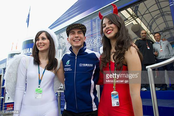 Jorge Lorenzo of Spain and Yamaha Factory Team poses with fans after the practice of MotoGp Of Catalunya at Circuit de Catalunya on June 3 2011 in...
