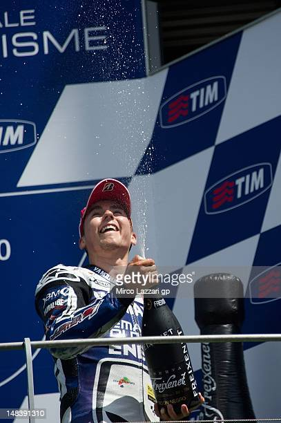 Jorge Lorenzo of Spain and Yamaha Factory Team sprays champagne as he celebrates on the podium at the end of the MotoGP race of the MotoGP of Italy...