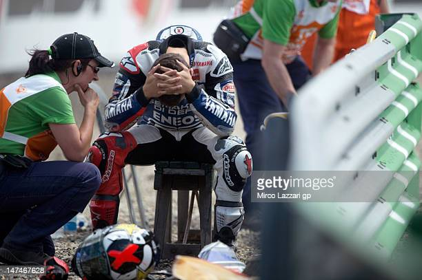 Jorge Lorenzo of Spain and Yamaha Factory Team thinks near the track after crashed out during the MotoGP race of the MotoGp Of Holland at TT Circuit...