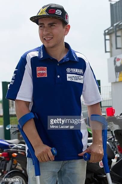 Jorge Lorenzo of Spain and Yamaha Factory Team walks on grid with crutches during the preevent MotoGP riders celebrate Sachsenring's 85th Anniversary...