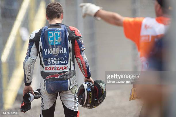 Jorge Lorenzo of Spain and Yamaha Factory Team walks out of track after crashed out during the MotoGP race of the MotoGp Of Holland at TT Circuit...