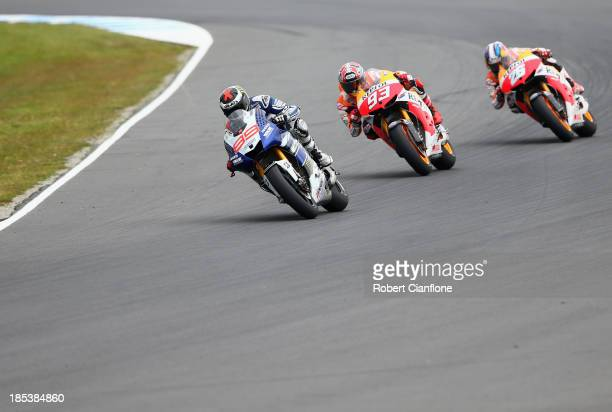 Jorge Lorenzo of Spain riding the Yamaha Factory Racing Yamaha is chased by Marc Marquez and Dani Pedrosa both of Spain and the Repsol Honda Team...