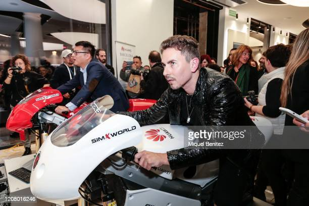 Jorge Lorenzo rides a Huawei motorcycle simulator during the inauguration of Huawei Flag Ship Barcelona at Plaça Catalunya on February 22, 2020 in...