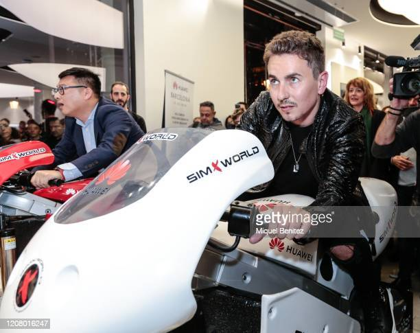 Jorge Lorenzo rides a Huawei motorcycle simulator during the inauguration of Huawei Flag Ship Barcelona at Plaça Catalunya on February 22 2020 in...