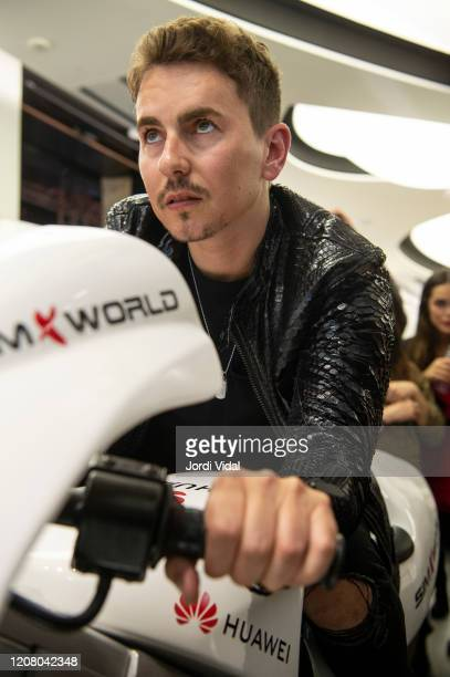 Jorge Lorenzo rides a motorbike simulator during the inauguration of Espai Huawei Flagship Barcelona at Plaça Catalunya on February 22 2020 in...