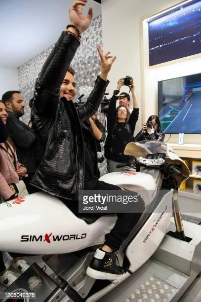 Jorge Lorenzo rides a motorbike simulator during the inauguration of Espai Huawei Flagship Barcelona at Plaça Catalunya on February 22, 2020 in...