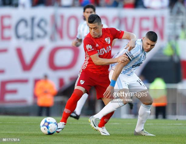 Jorge Luis Moreira of River Plate fights for the ball with David Barbona of Atletico de Tucuman during a match between River Plate and Atletico de...