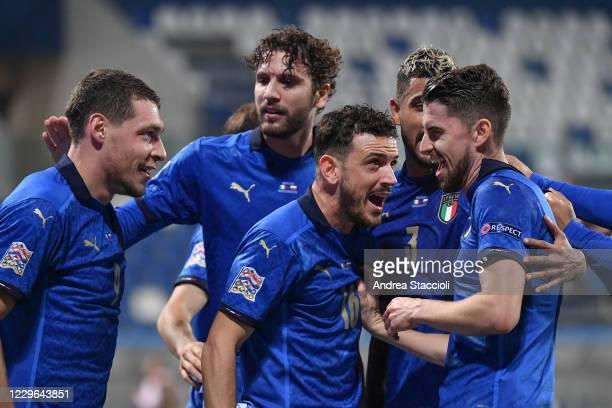 Jorge Luiz Frello Filho Jorginho of Italy celebrates with Alessandro Florenzi and team mates after scoring a goal on penalty during the Uefa Nation...