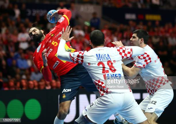 Jorge Maqueda Pena of Spain is challenged by Zeljko Musa ans Marko Mamic of Croatia during the Men's EHF EURO 2020 final match between Spain and...