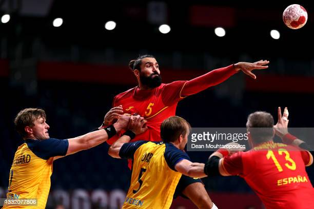 Jorge Maqueda Peno of Team Spain passes the ball while under pressure from Jonathan Carlsbogard and Max Darj of Team Sweden during the Men's...