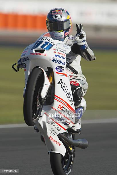 Jorge Martin of Spain and Aspar Team Moto3 lifts the front wheel and greets during the MotoGP of Valencia Qualifying at Ricardo Tormo Circuit on...