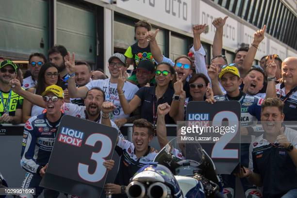 Jorge Martin of Spain and Del Conca Gresini Moto3 and Fabio Di Giannantonio of Italy and Del Conca Gresini Moto3 celebrate with team under the podium...