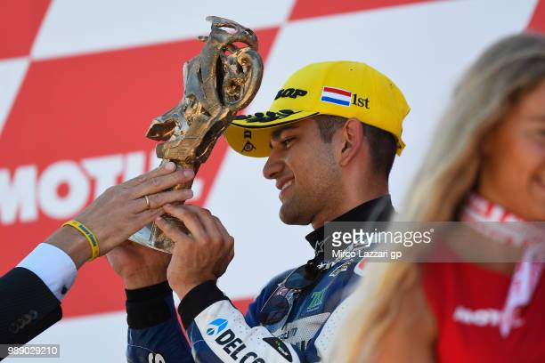 Jorge Martin of Spain and Del Conca Gresini Moto3 celebrates the victory on the podium at the end of the Moto3 race during the MotoGP Netherlands...