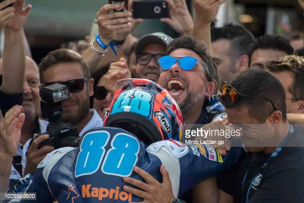 Jorge Martin of Spain and Del Conca Gresini Moto3 celebrates the second place with team under the podium at the end of the Moto3 race during the...