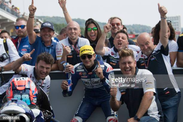 Jorge Martin of Spain and Del Conca Gresini Moto3 celebrates the victory with team under the podium at the end of the Moto3 race during the MotoGp of...