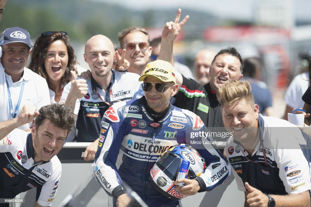 Jorge Martin of Spain and Del Conca Gresini Moto3 celebrates with team the pole position at the end of the qualifying practice during the MotoGp of Germany - Qualifying at Sachsenring Circuit on July 14, 2018 in Hohenstein-Ernstthal, Germany.
