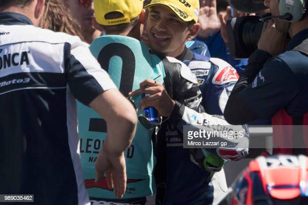 Jorge Martin of Spain and Del Conca Gresini Moto3 hugs Enea Bastianini of Italy and Leopard Racing under the podium at the end of the Moto3 race...