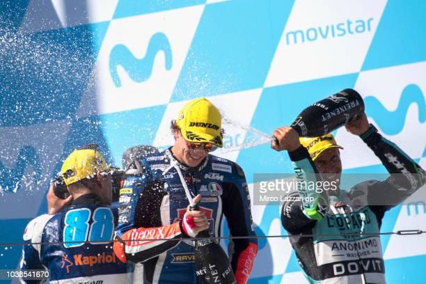 Jorge Martin of Spain and Del Conca Gresini Moto3 Marco Bezzecchi of Italy and Pruestel GP and Enea Bastianini of Italy and Leopard Racing celebrate...