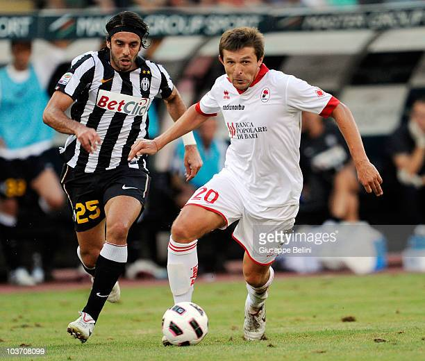 Jorge Martinez of Juventus and Vitali Kutuzov of Bari in action during the Serie A match between Bari and Juventus at Stadio San Nicola on August 29,...