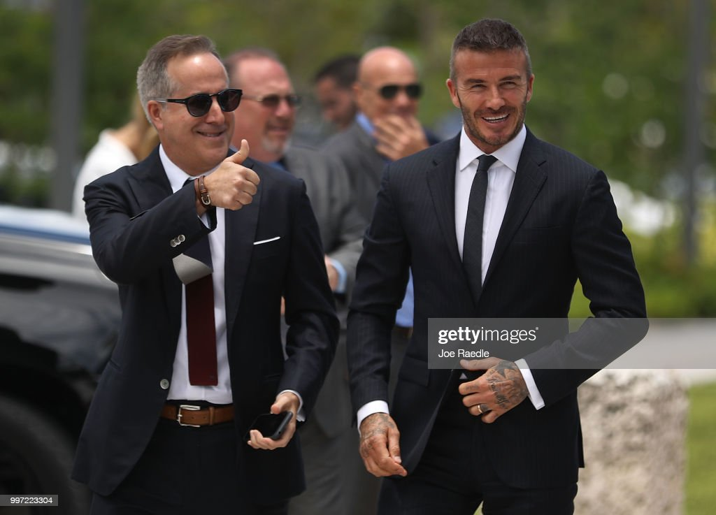 Jorge Mas (L) and David Beckham arrive for a rally being held next to Miami City Hall in support of building a Major League Soccer stadium on July 12, 2018 in Miami, Florida. Mr. Beckham and his partners were planning on going before the City of Miami for a public hearing in their effort to build a Major League Soccer stadium in the City of Miami for their professional soccer team.