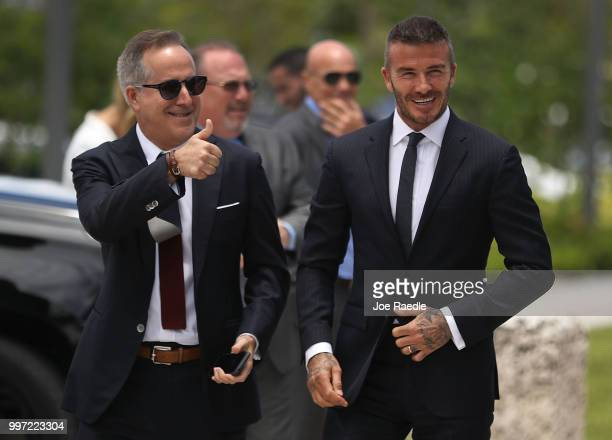 Jorge Mas and David Beckham arrive for a rally being held next to Miami City Hall in support of building a Major League Soccer stadium on July 12...