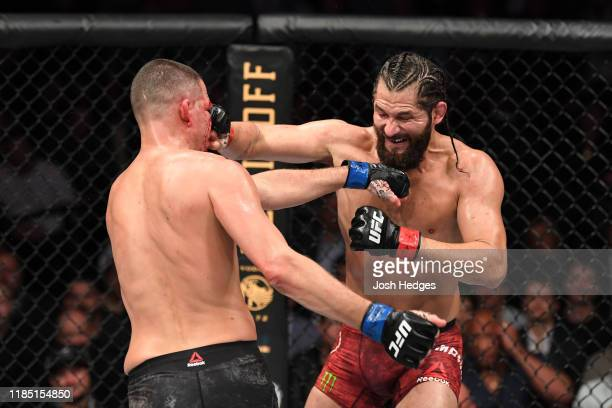 Jorge Masvidal and Nate Diaz exchange punches in their welterweight bout for the BMF title during the UFC 244 event at Madison Square Garden on...