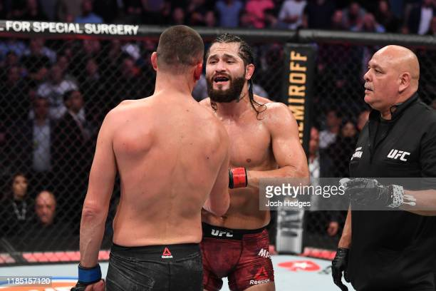 Jorge Masvidal and Nate Diaz interact after the doctor's stoppage in their welterweight bout for the BMF title during the UFC 244 event at Madison...