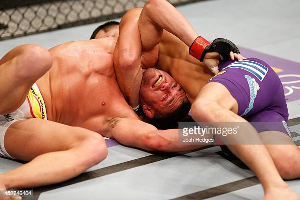 Jorge Masvidal attempts to secure a darce choke against Daron Cruickshank in their lightweight bout during the UFC Fight Night event at SAP Center on...