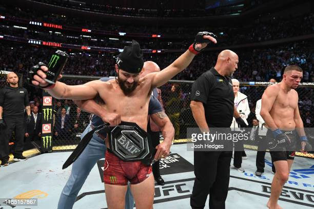 Jorge Masvidal celebrates his victory over Nate Diaz in their welterweight bout for the BMF title during the UFC 244 event at Madison Square Garden...