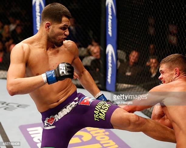 Jorge Masvidal kicks Daron Cruickshank in their lightweight bout during the UFC Fight Night event at SAP Center on July 26 2014 in San Jose California