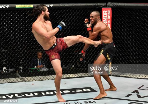 Jorge Masvidal kicks Kamaru Usman of Nigeria in their UFC welterweight championship fight during the UFC 251 event at Flash Forum on UFC Fight Island...