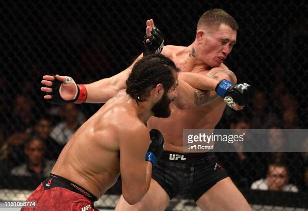 Jorge Masvidal knocks down Darren Till of England with a left in their welterweight bout during the UFC Fight Night event at The O2 Arena on March 16...