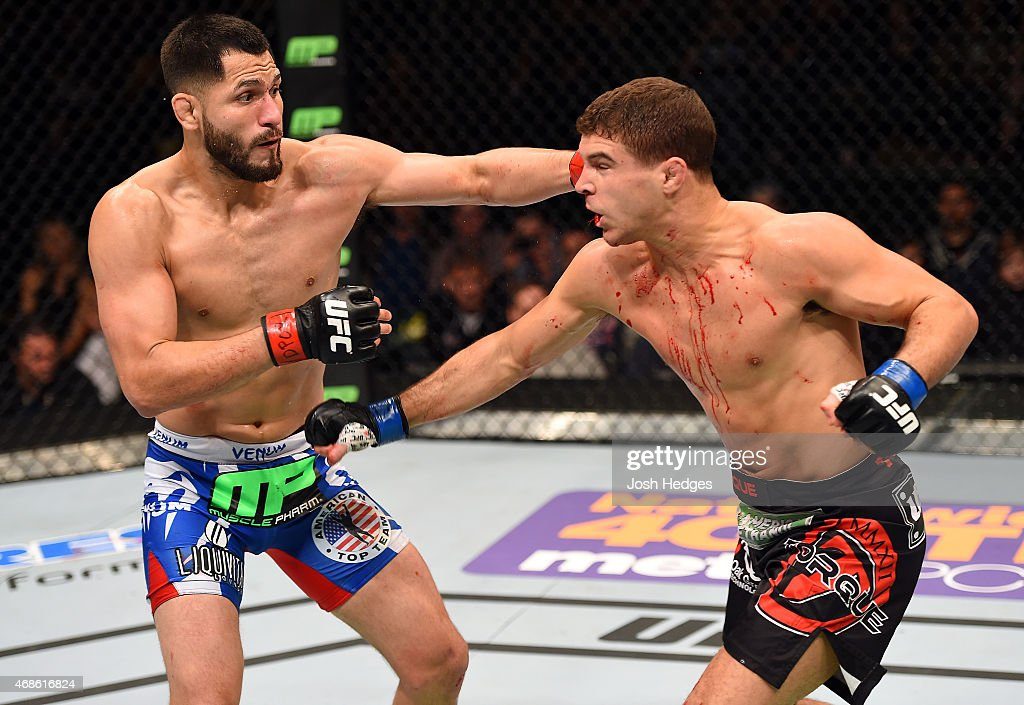 Jorge Masvidal lands a punch to the head of Al Iaquinta in their lightweight fight during the UFC Fight Night event at the Patriot Center on April 4, 2015 in Fairfax, Virginia.