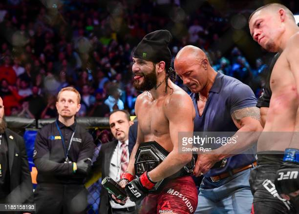 Jorge Masvidal of the United States is awarded the belt by Dwayne the Rock Johnson after his victory by TKO on a medical stoppage against Nate Diaz...